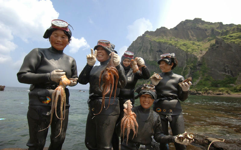 Haenyo women posing with their catch of the day (Pic credit: Jeju Tourism)